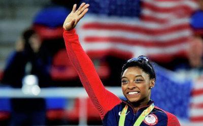 Olympic gold medalist Simone Biles smiling
